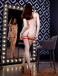 Nicki Adani sensually strips in front of the mirror baring her sweet pussy.kelly d met art