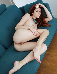 Redhead Adel C shows off her smoking hot body as she strips on the couch.met art josephine