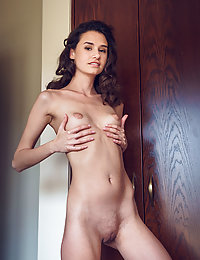 Cristin strips in the bedroom baring her petite body.met art hunters
