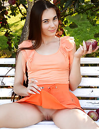 Newcomer Lola Cherie shows off her nubile body as she poses on the bench.masha j met art