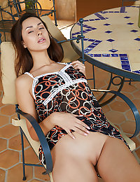 Sultry Angelina Socho displays her amazing tits and curvy hips on the chair.met art andrea