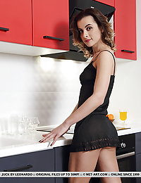 Juck strips in the kitchen baring her yummy, slender body.herge met art