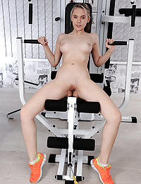 Eva Jude strips in the gym as she poses on the exercise equipment.fergie met art