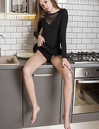 Madison strips on the kitchen counter top baring her delectable pussy.met art mariko