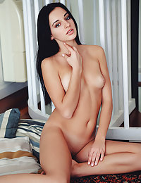 Alluring Sultana shows off her sexy, slender body as she strips on the floor.danae a met art